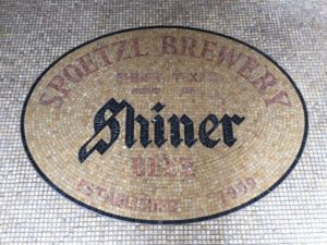 Mosaic tile greets visitors to K Spoetzl Brewery in Shiner, TX.