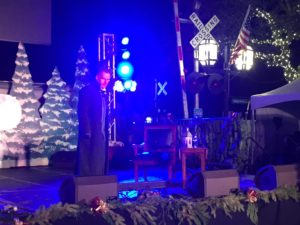 """Jason Woods performing """"A Christmas Carol"""" at Dickens on Centre."""