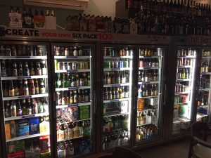 Wall-length beer case at The Vintner