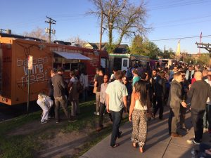 Food trucks and crowds at Denver First Friday Art Walk.