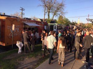 Food trucks and crowds at Denver First Friday Art Walk.