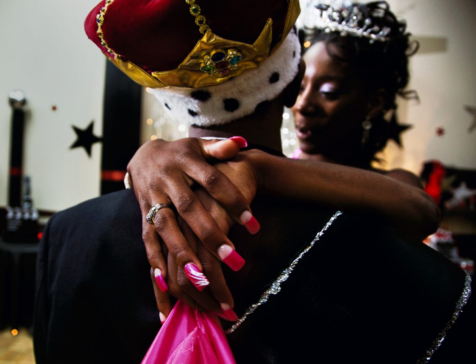 Top: Gillian Laub, Prom king and queen, dancing at the black prom, Vidalia, Georgia, 2009. © Gillian Laub, Courtesy of Benrubi Gallery.