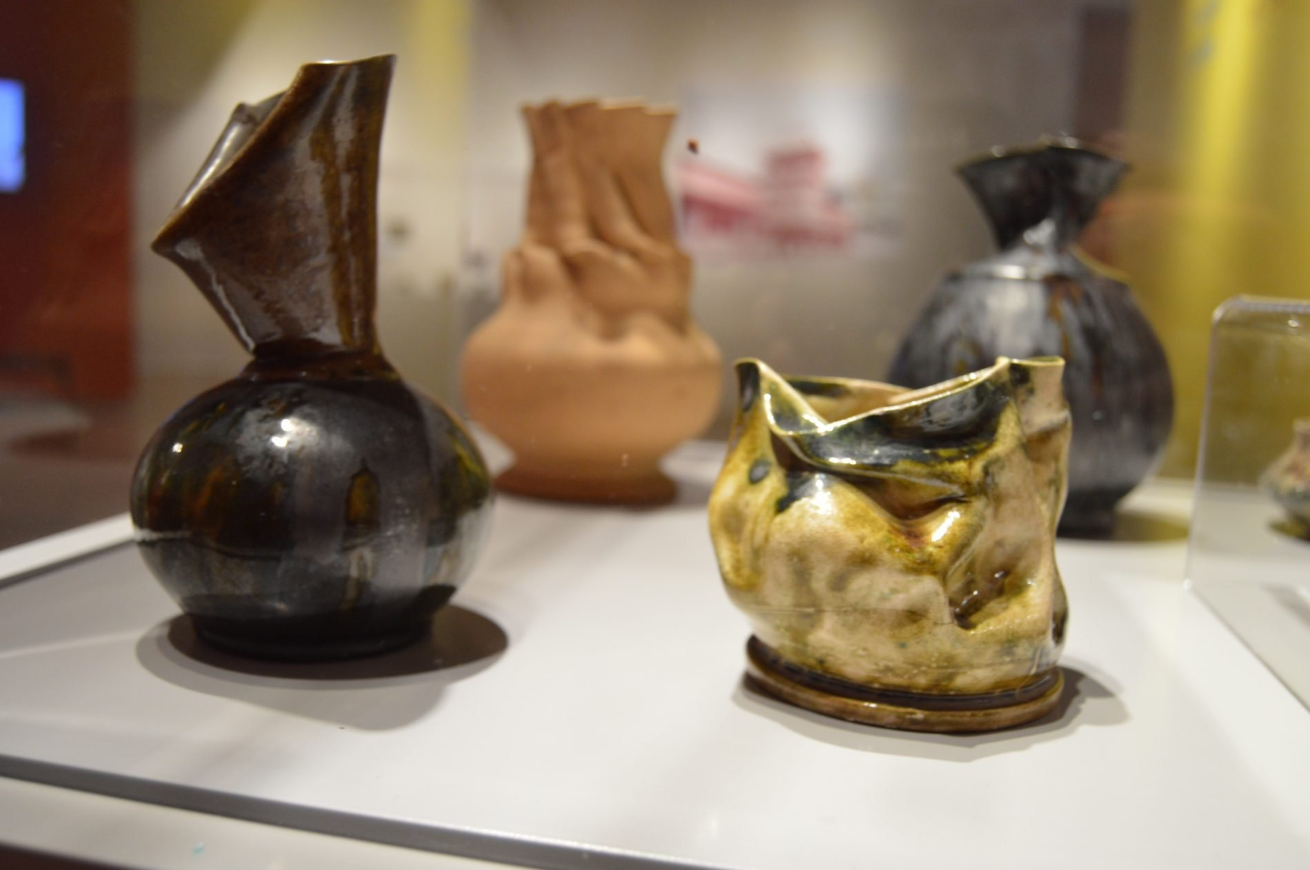 """Installation view of """"Deliberately Distorted: The Pottery of George E. Ohr,"""" at The MAX in Meridian, MS."""