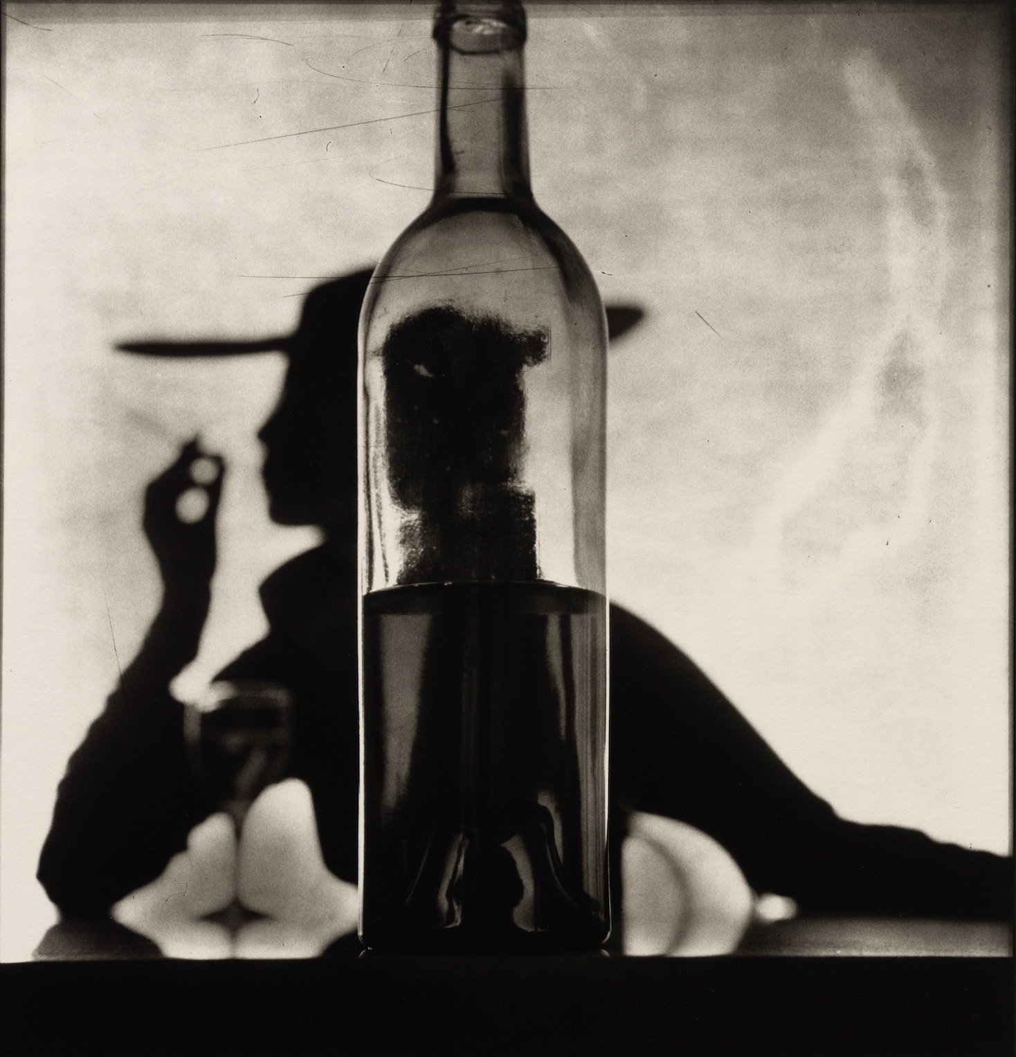 Irving Penn, Girl Behind Bottle (Jean Patchett), 1949 © The Irving Penn Foundation, courtesy of Pace Gallery.