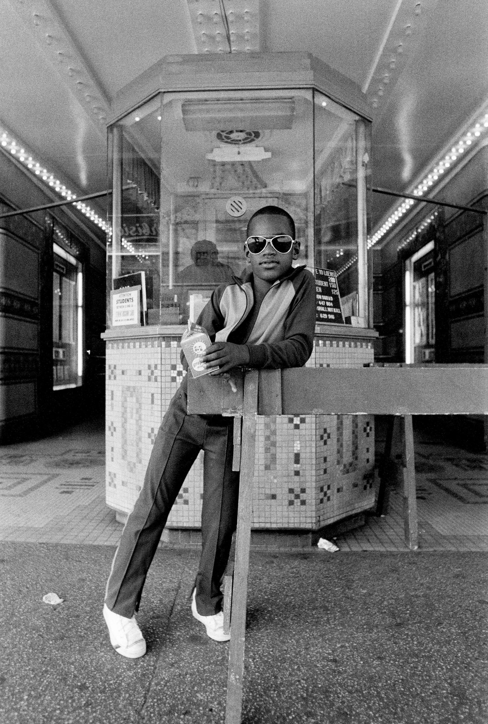 A Boy in Front of the Loews 125th Street Movie Theater, Harlem NY (1976)