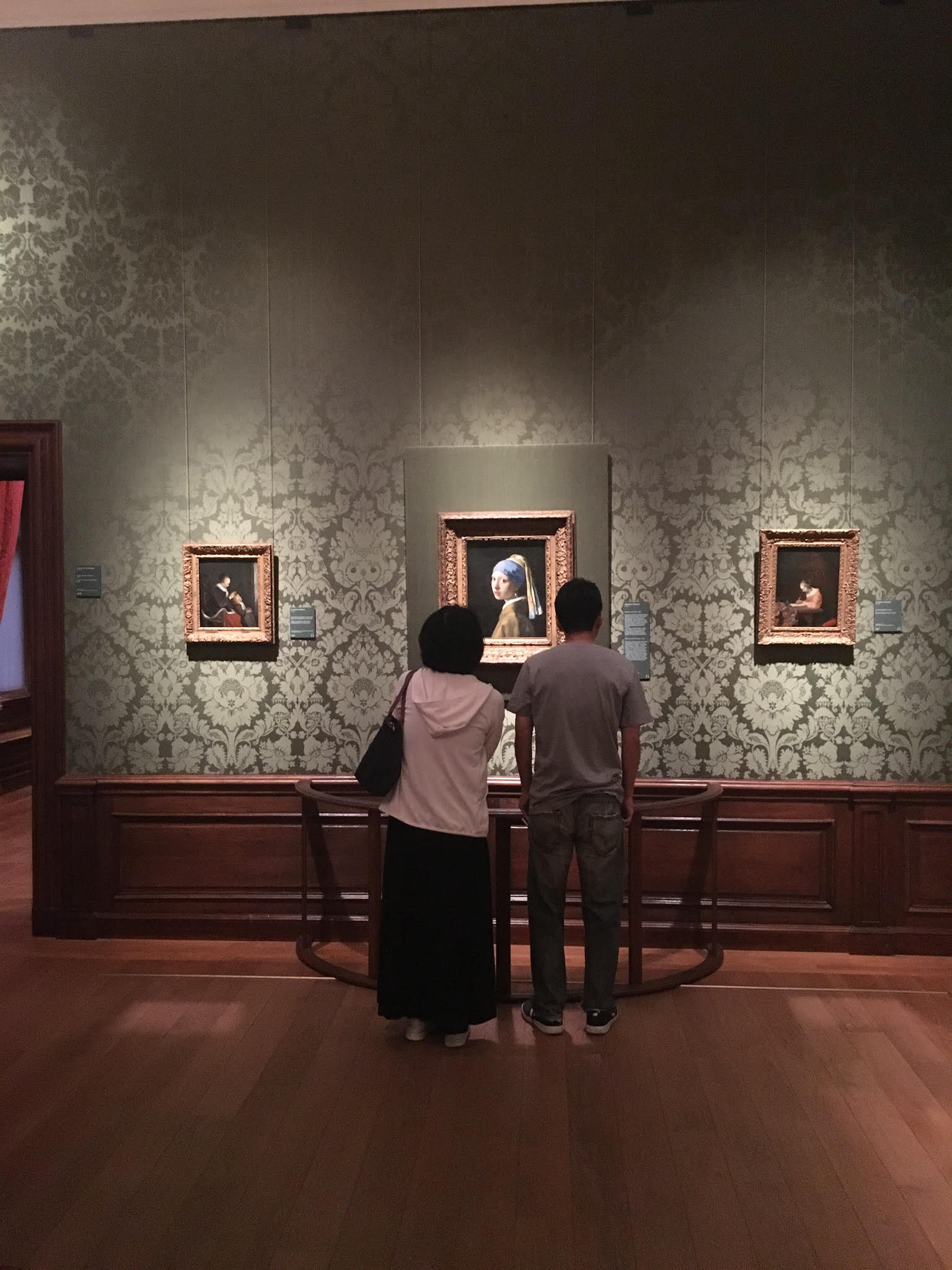 Visitors at the Mauritshuis enjoy time alone with Vermeer's Girl with a Pearl Earring painting.