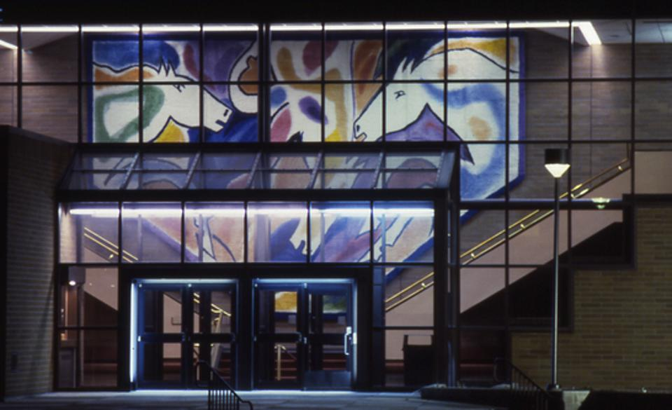 Rudy Autio (design), Anneli Hartikainen (weaving), 'Montana Horses,' Rya tapestry, wool, 1986, 16 x 30.' PARTV Center at night. Collection of the Montana Museum of Art and Culture, The University of Montana, Missoula. UNIVERSITY OF MONTANA, MISSOULA