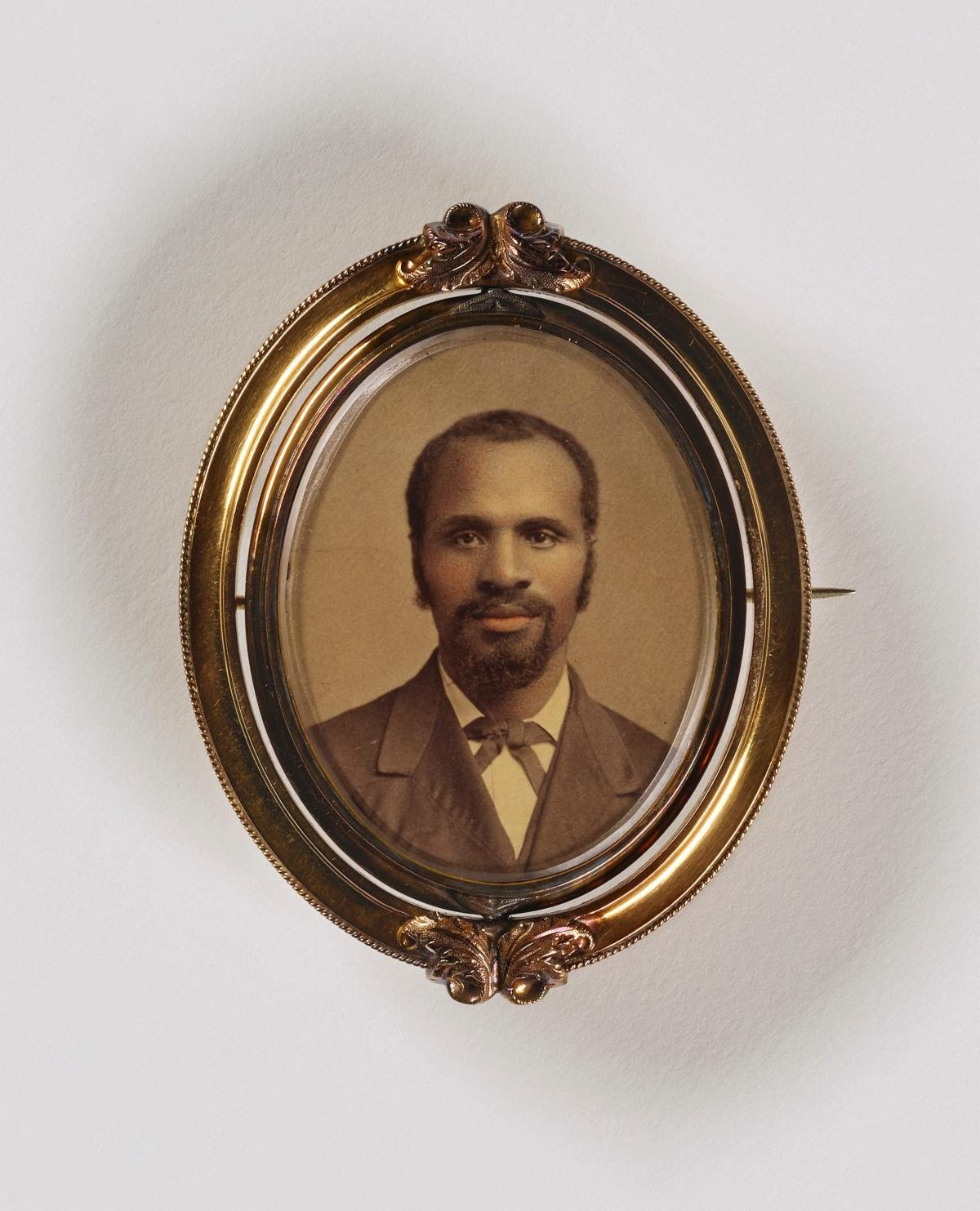 Unidentified artist, Untitled (brooch, man with goatee), undated, albumen print in metal setting.Smithsonian American Art Museum, the L. J. West Collection of Photographic Jewelry, Museum purchase made possible through the Franz H. and Luisita L. Denghausen Endowment