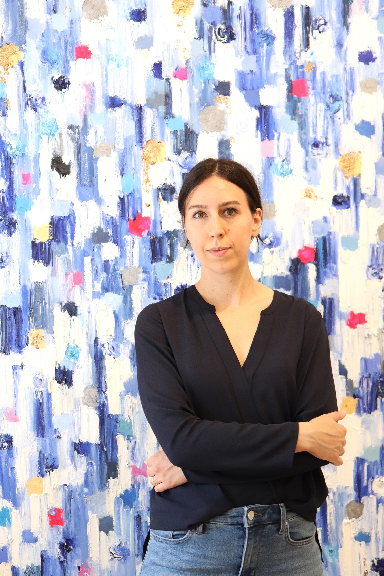 """Cindy Shaoul in front of a """"Dripping Dots"""" painting."""