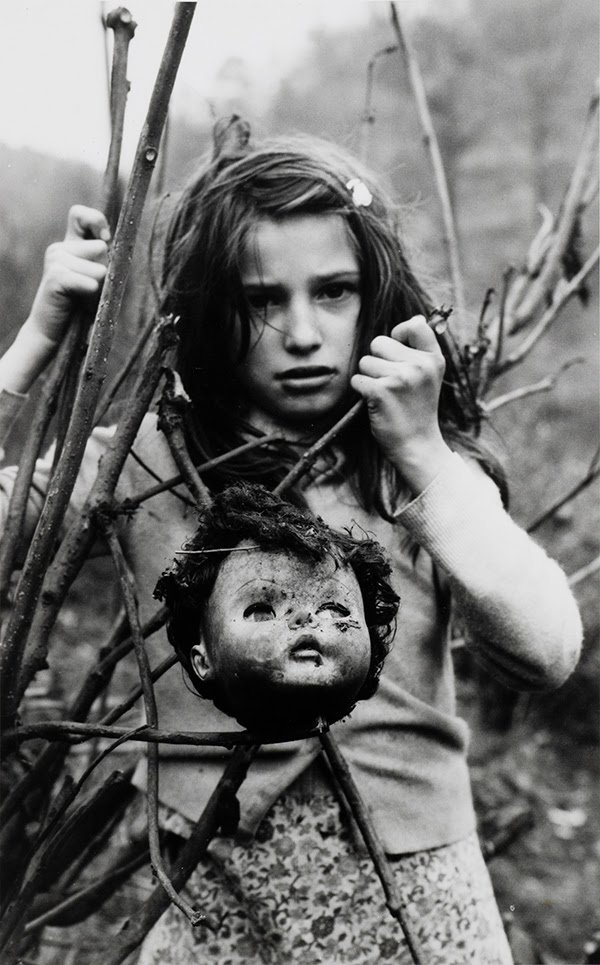 """Arthur Tress (American, b. 1940), """"Girl with Doll, Keystone, WV,"""" 1968. Fiber-based gelatin silver print. Georgia Museum of Art, University of Georgia; Gifted by Dr. Pat and Patricia Kennedy. GMOA 2020.2026."""